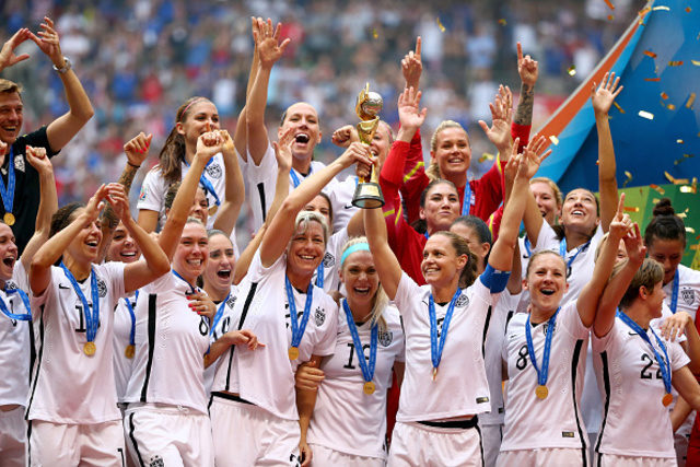 VANCOUVER, BC - JULY 05:  Abby Wambach #20 and Christie Rampone #3 of the United States of America hold the World Cup Trophy after their 5-2 win over Japan in the FIFA Women's World Cup Canada 2015 Final at BC Place Stadium on July 5, 2015 in Vancouver, Canada.  (Photo by Ronald Martinez/Getty Images)