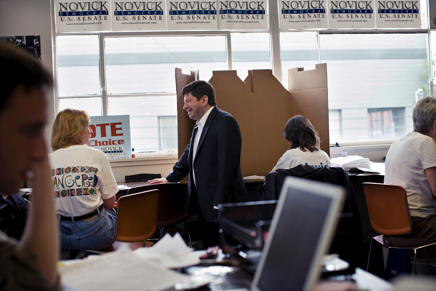 Steve Novick (Democrat for U.S. Senate), center standing, talks with a volunteer Diane Hopper, second from left, at his campaign headquarter in SE Portland.